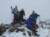 Pico Miruellu( a pesar del mal tiempo algunos compañeros en la cumbre)